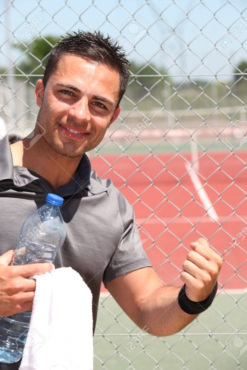 Male tennis player with bottle of water and towel Stock Photo - 11604237
