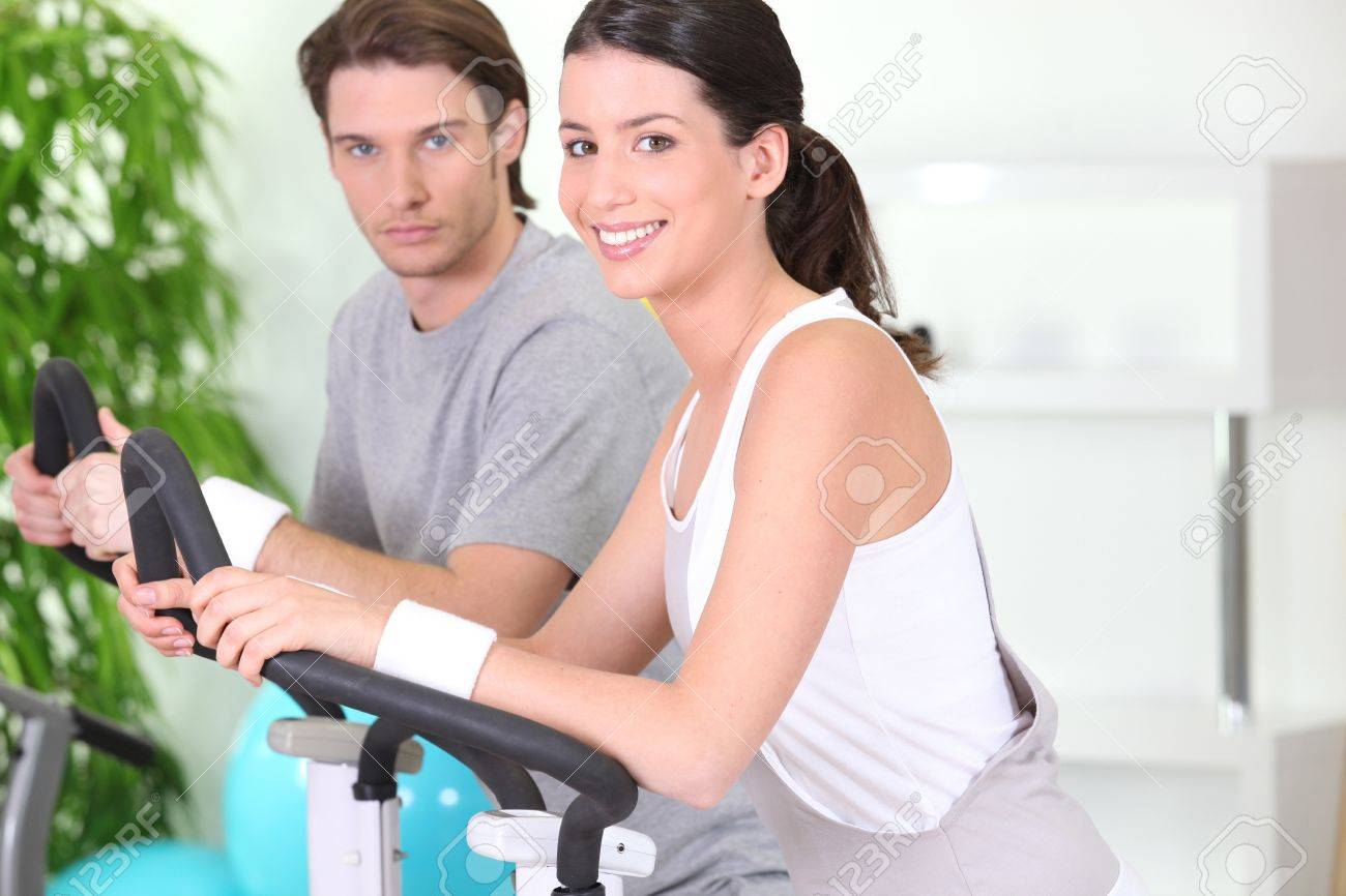 Young couple using gym equipment Stock Photo - 11604578