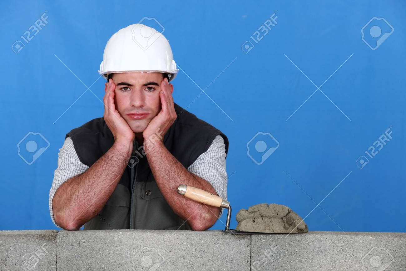 A frustrated bricklayer Stock Photo - 11612384