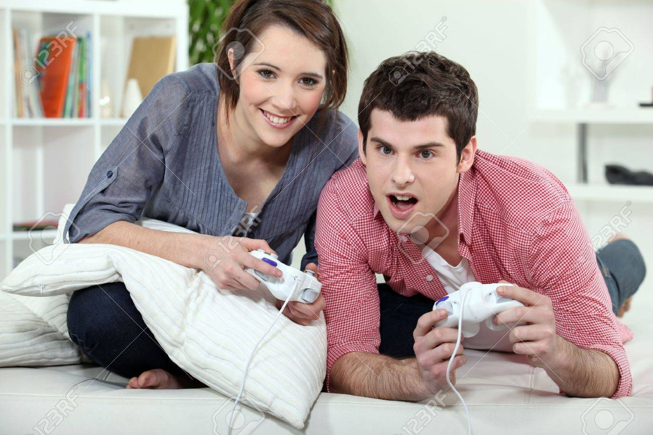 Young couple playing a video game together - 11612325