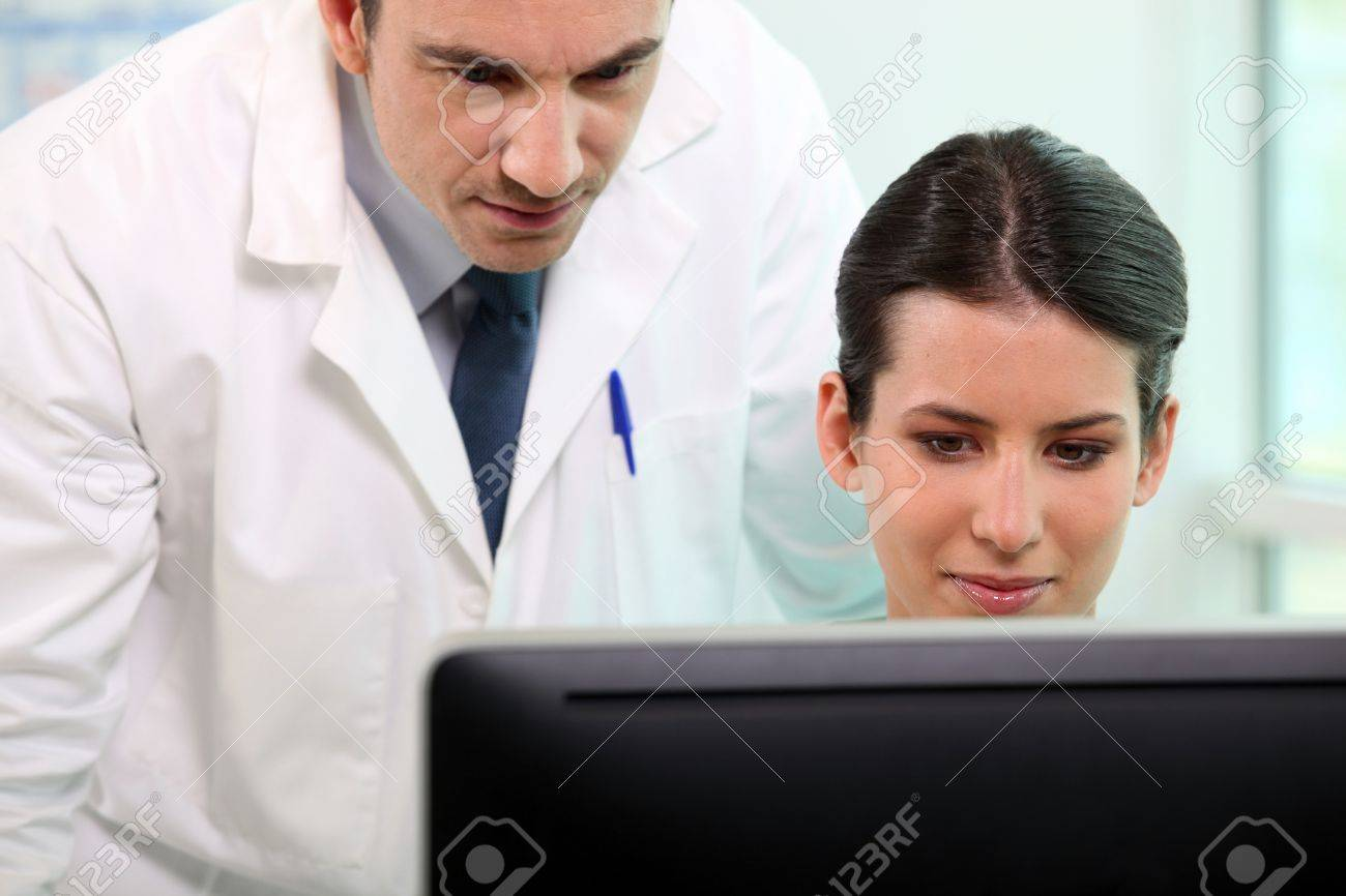 Nurse and doctor looking at computer screen Stock Photo - 11612974