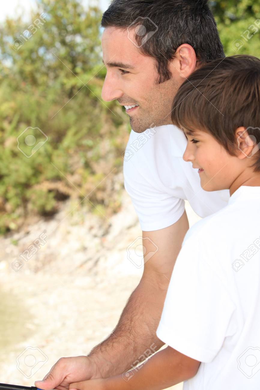 A father and his son fishing. Stock Photo - 11674379