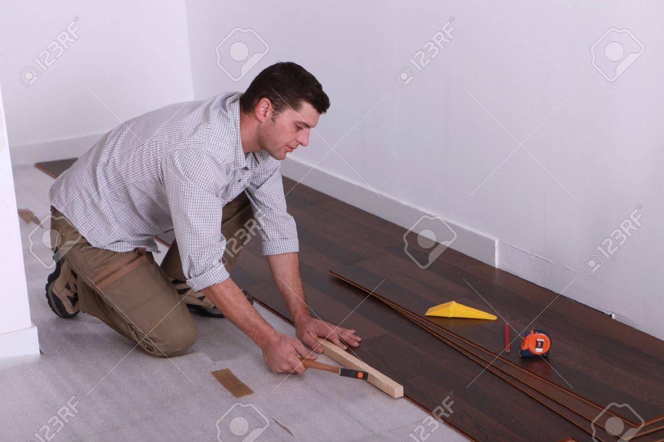 craftsman putting a wood flooring Stock Photo - 11755448