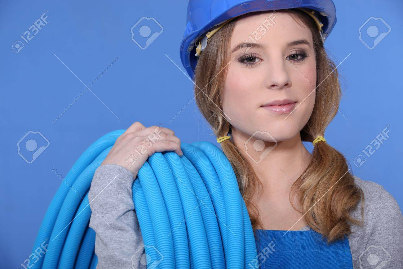 Attractive woman holding corrugated tubing Stock Photo - 11756204