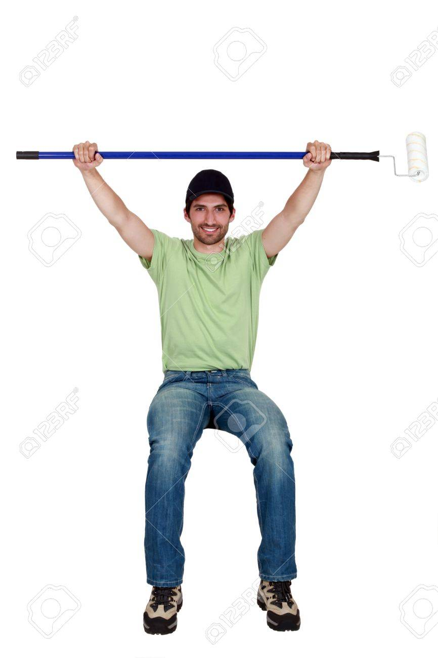 Tradesman sitting on an invisible object and holding up a paint roller Stock Photo - 11754204
