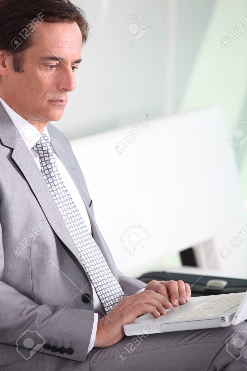Businessman on laptop Stock Photo - 11776252