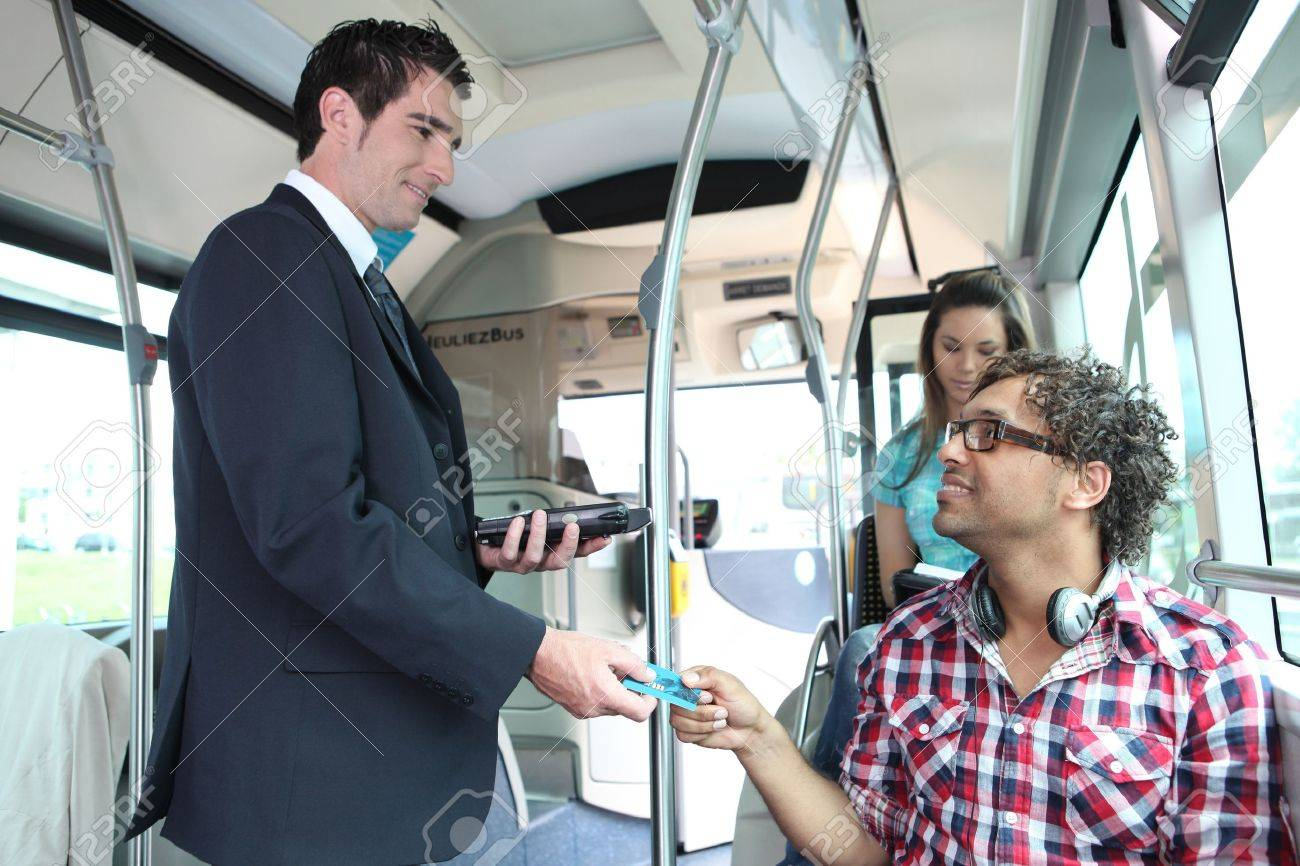 A young controller controlling passengers in a bus. Stock Photo - 11776893