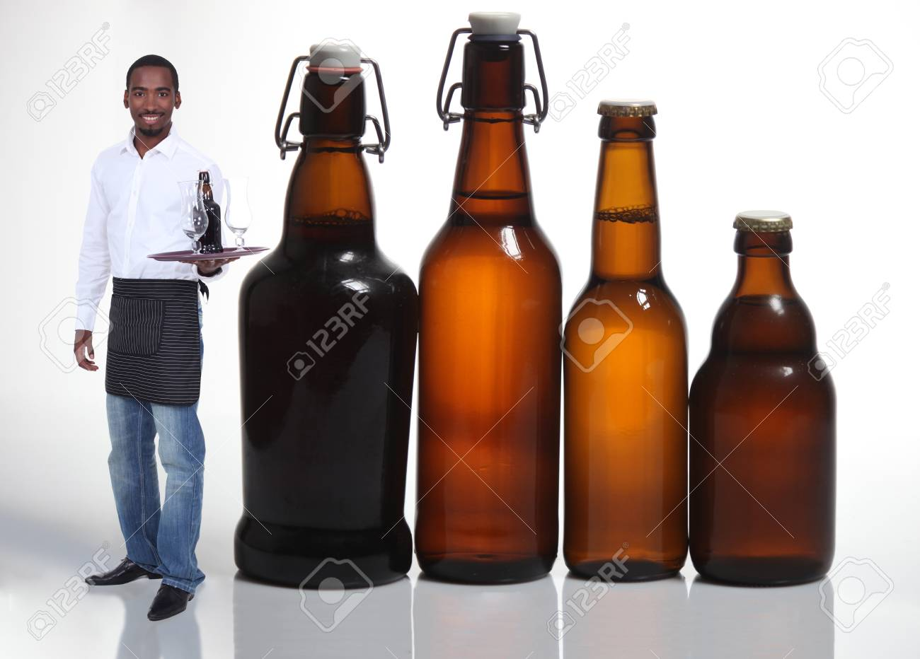 Waiter with beer bottles Stock Photo - 11797614