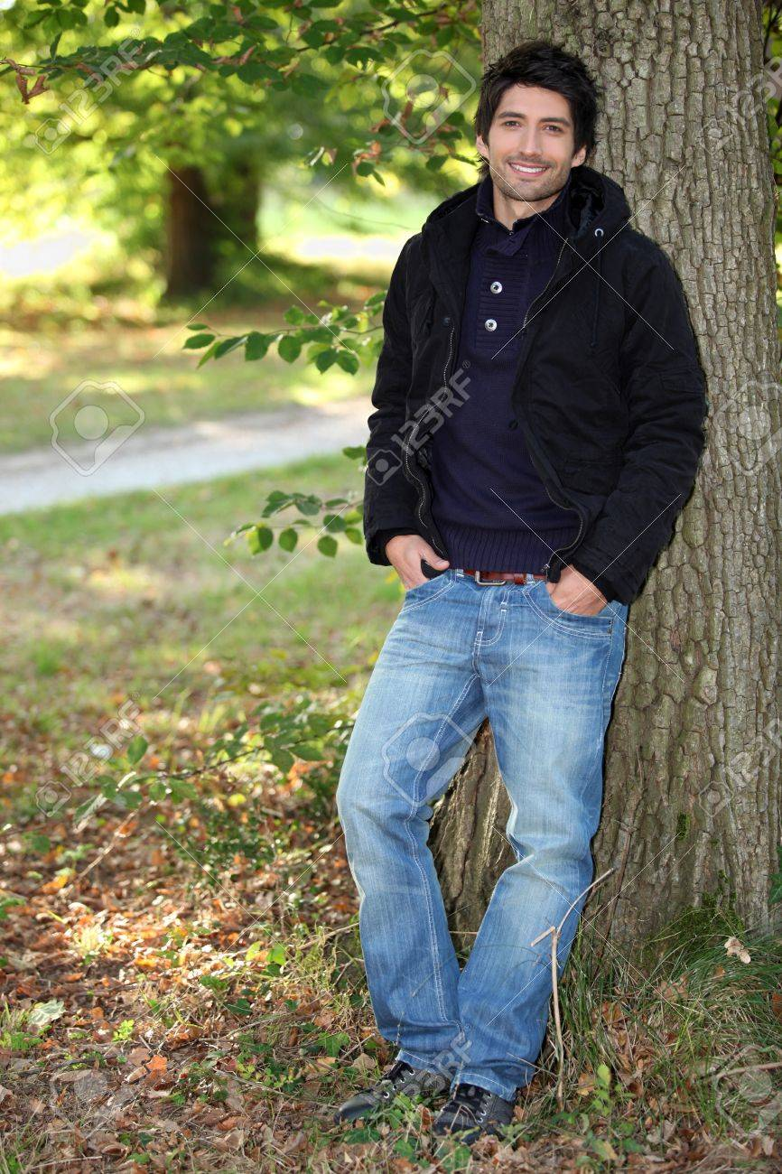 young man near a tree in autumn Stock Photo - 11795394