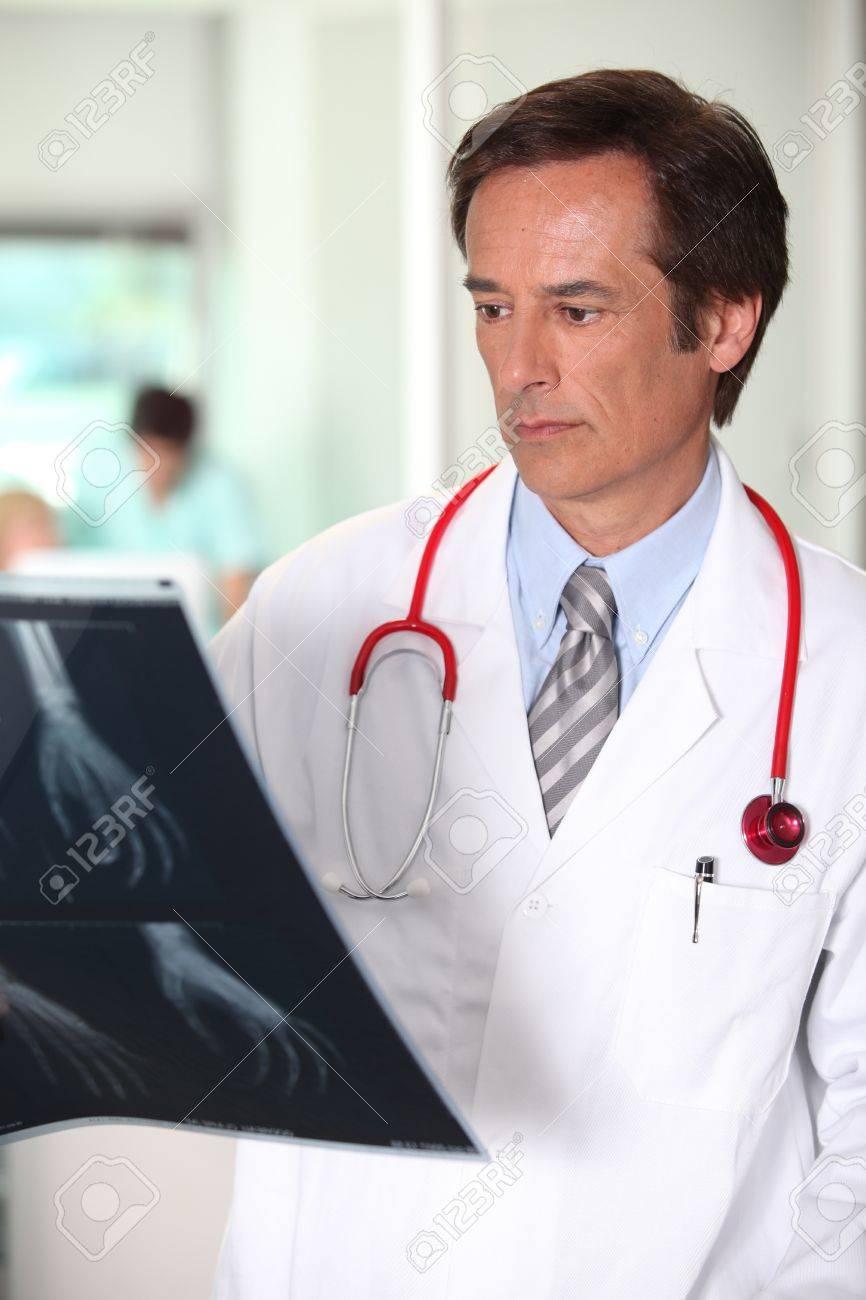 Male doctor analysing x-rap image Stock Photo - 11797300