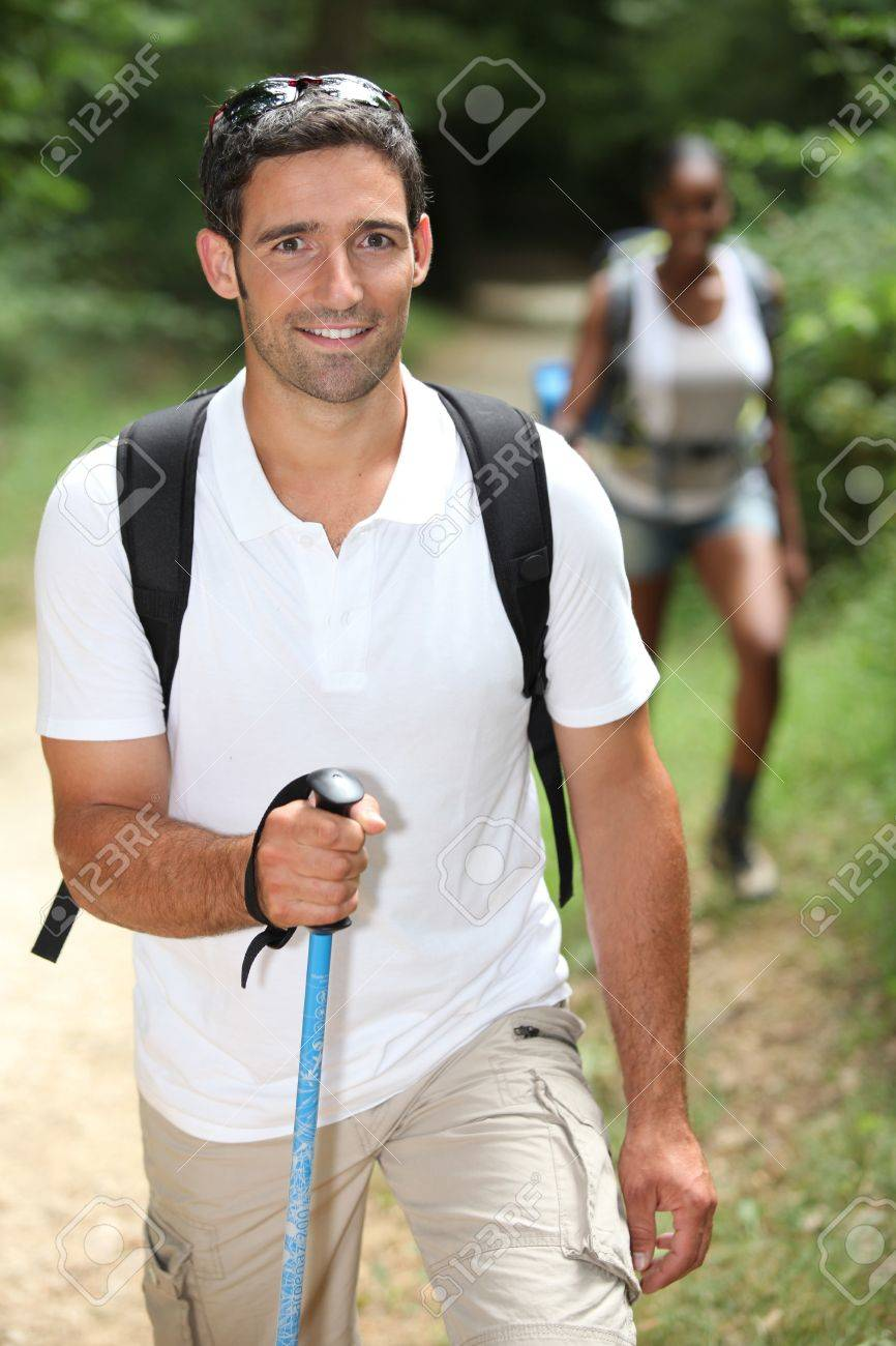 Interracial couple hiking in the forest Stock Photo - 11797007