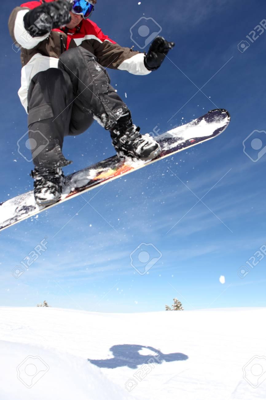 Snowboarder gliding through the air Stock Photo - 11795279