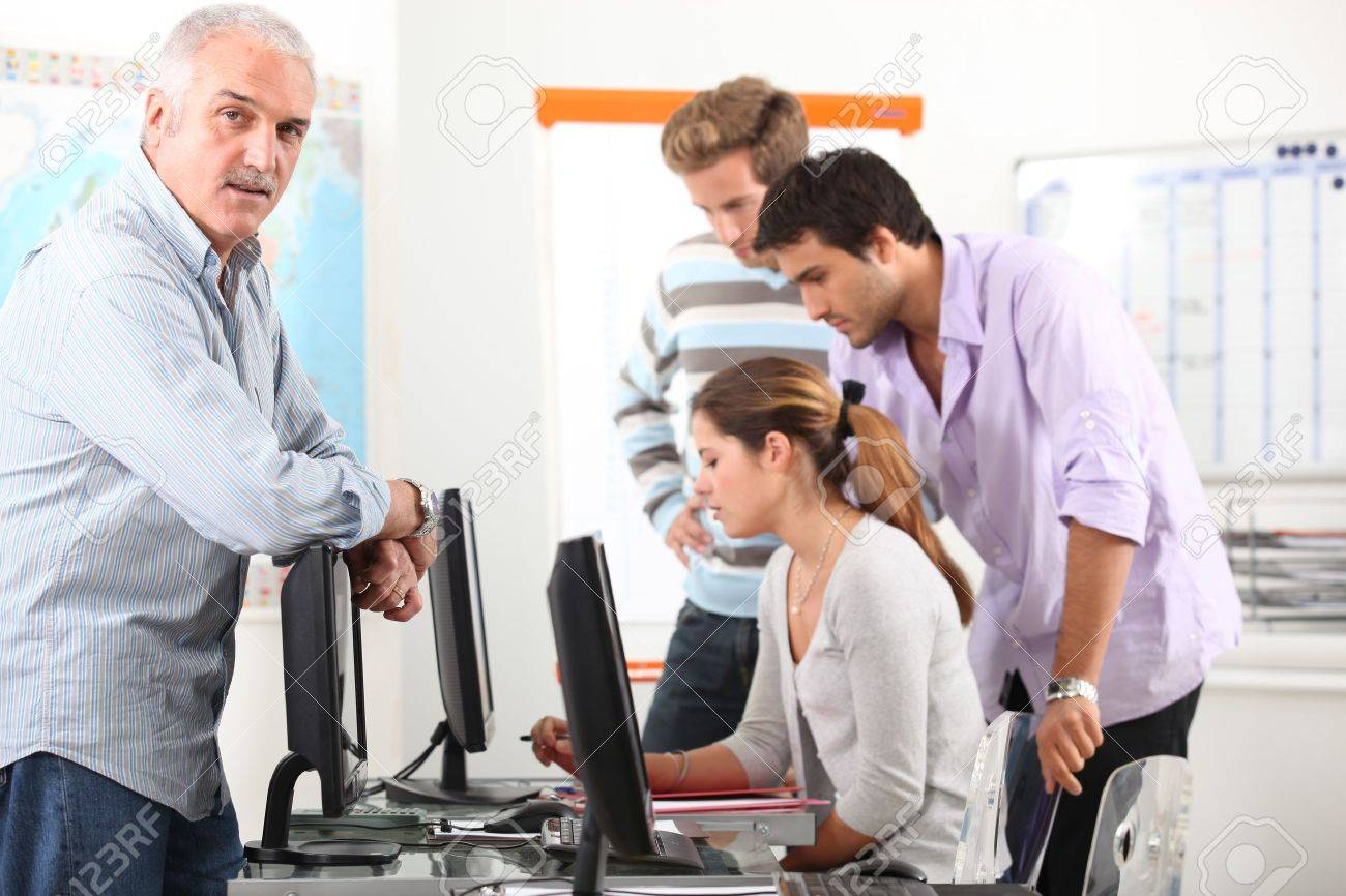 Manager and his team working at computers Stock Photo - 11825474