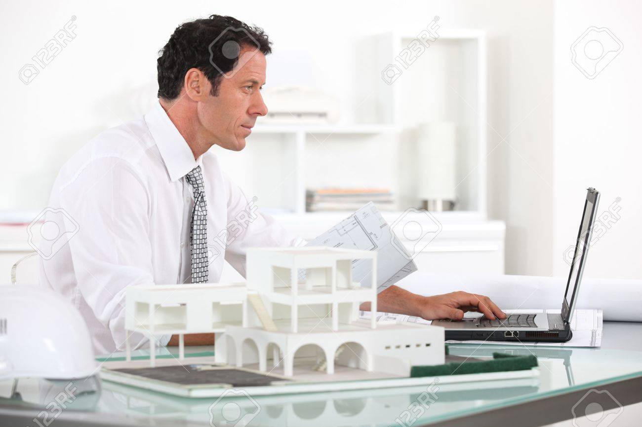 Architect working in his office Stock Photo - 11824643