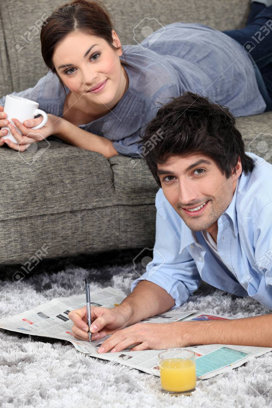 couple reading newspaper at home Stock Photo - 11824355