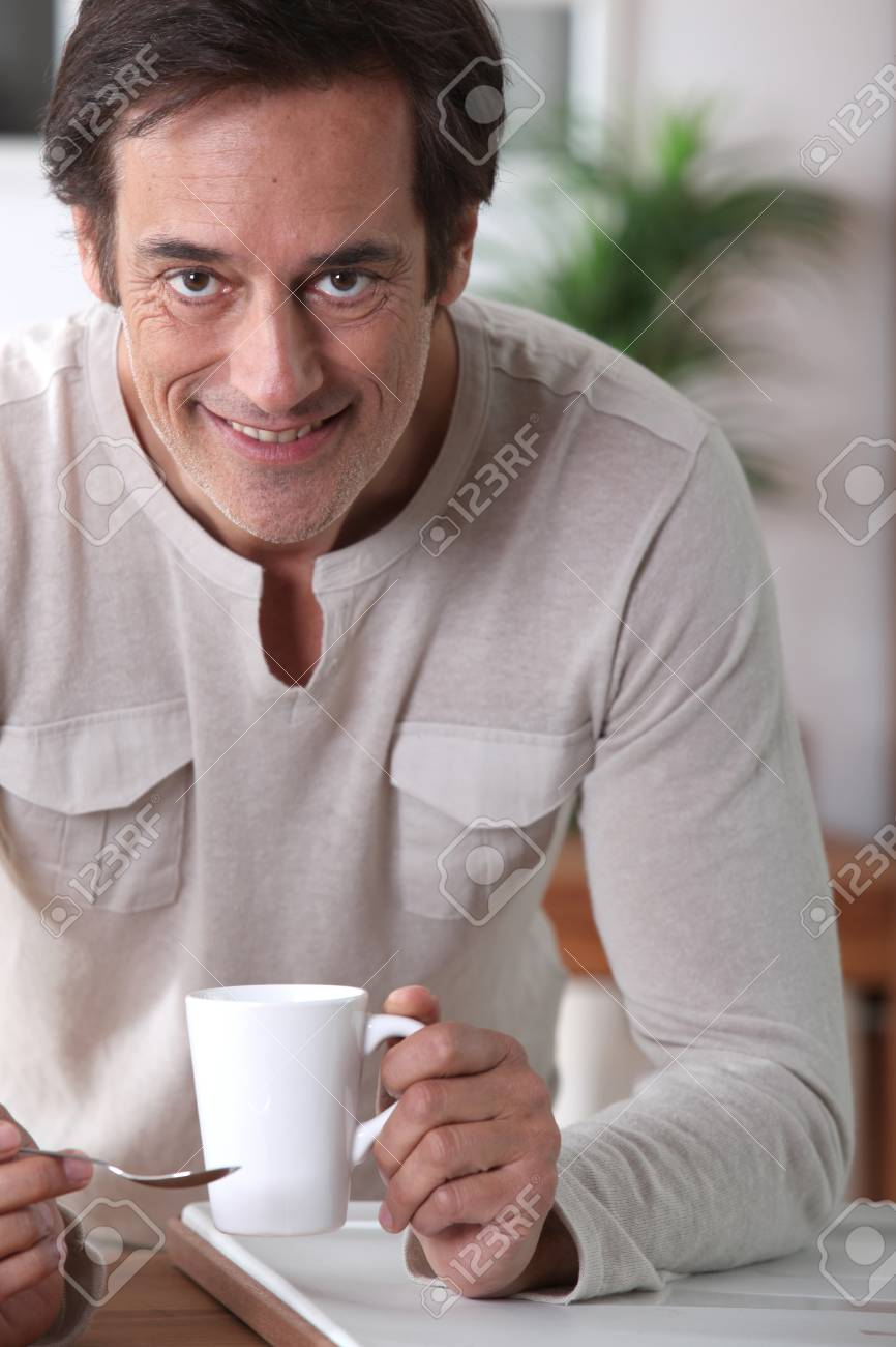 Man smiling with a cup of tea. Stock Photo - 11824767