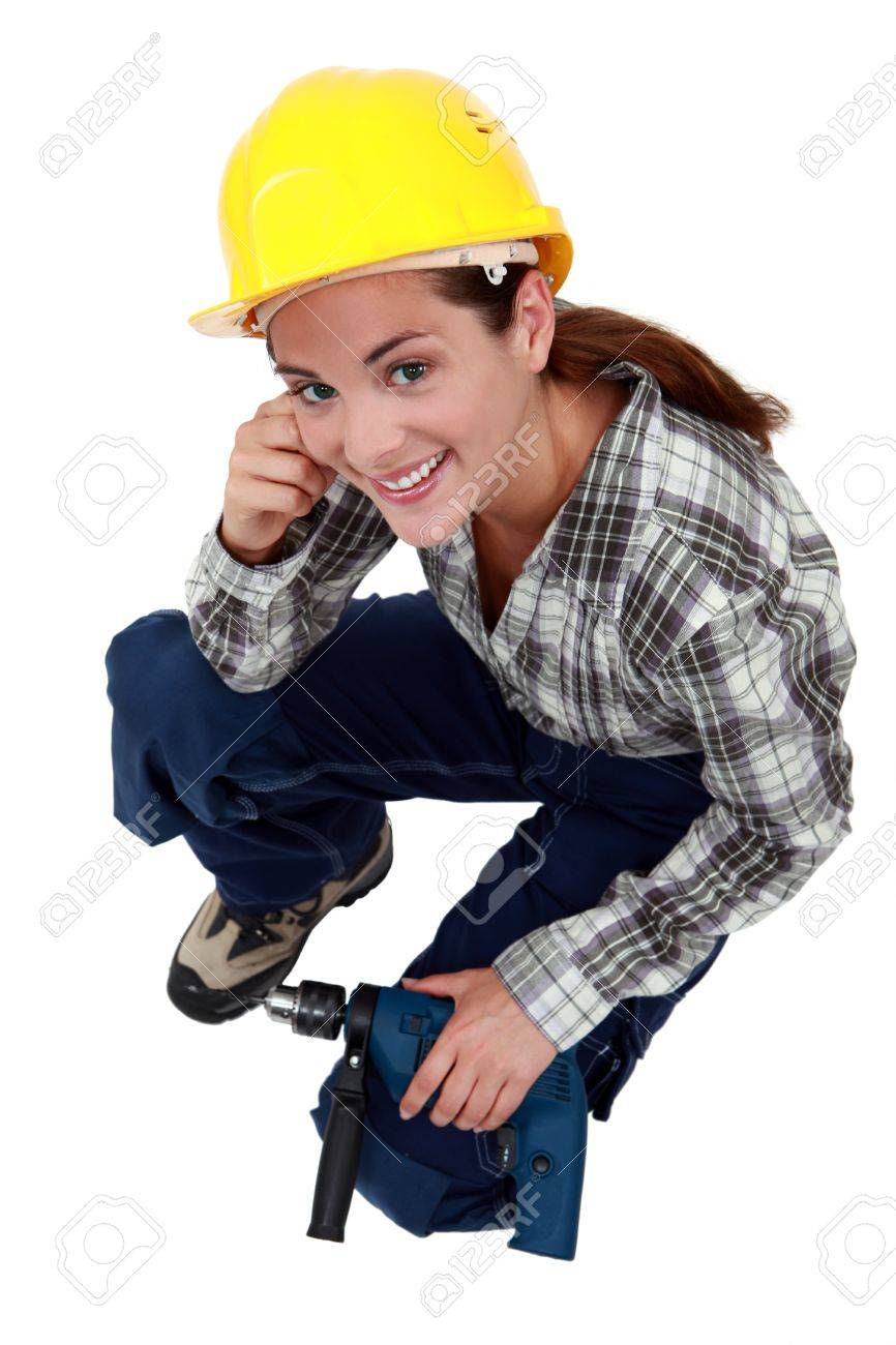 A female construction worker with a drill. Stock Photo - 11823185