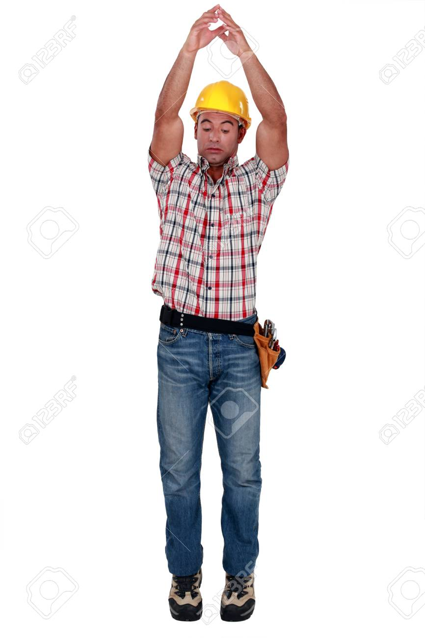 Tradesman raising his arms over his head Stock Photo - 11842904