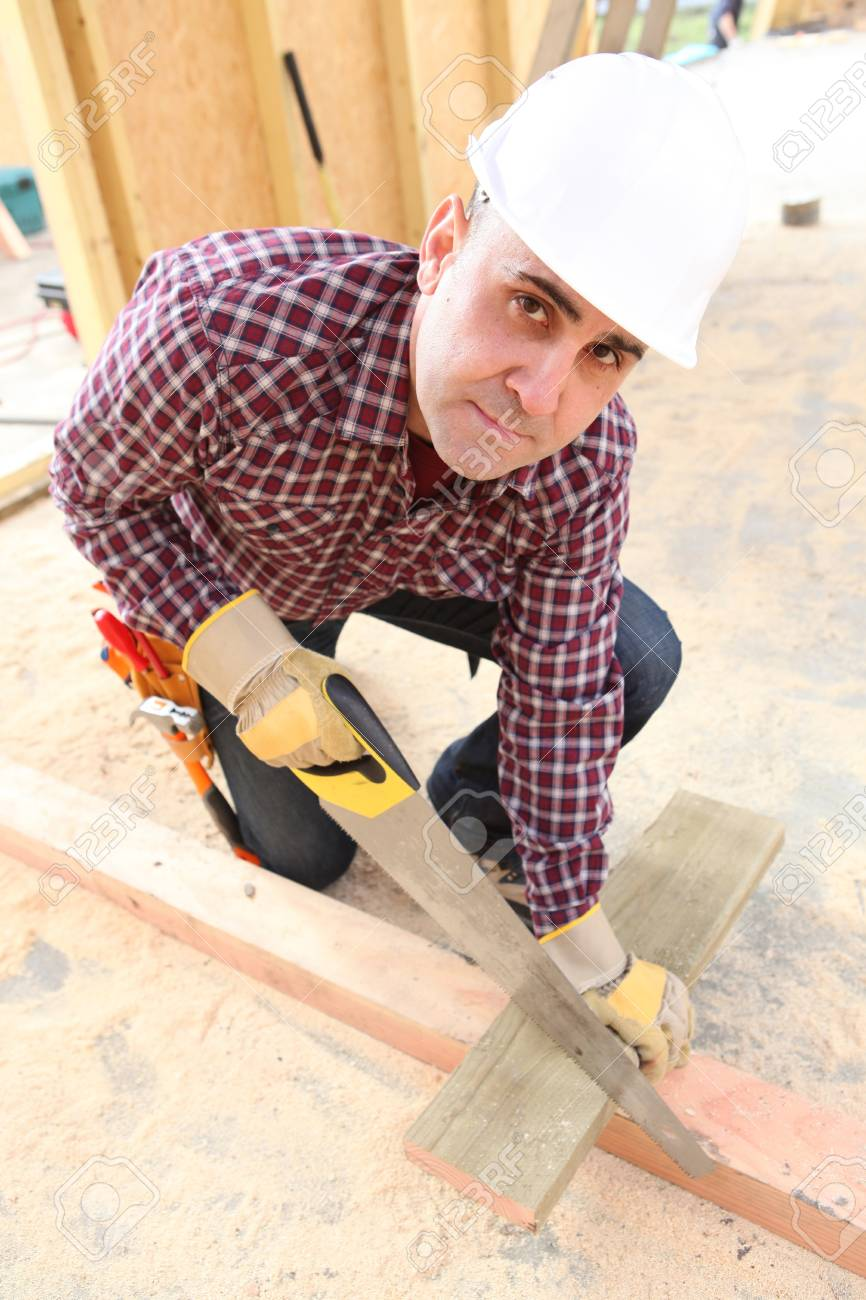 Builder sawing wood Stock Photo - 11842548