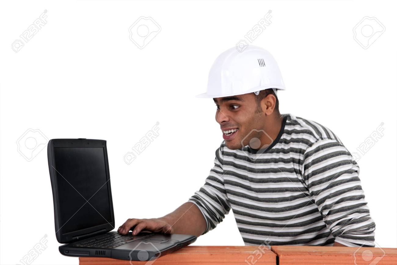 Young mason with computer Stock Photo - 11842492