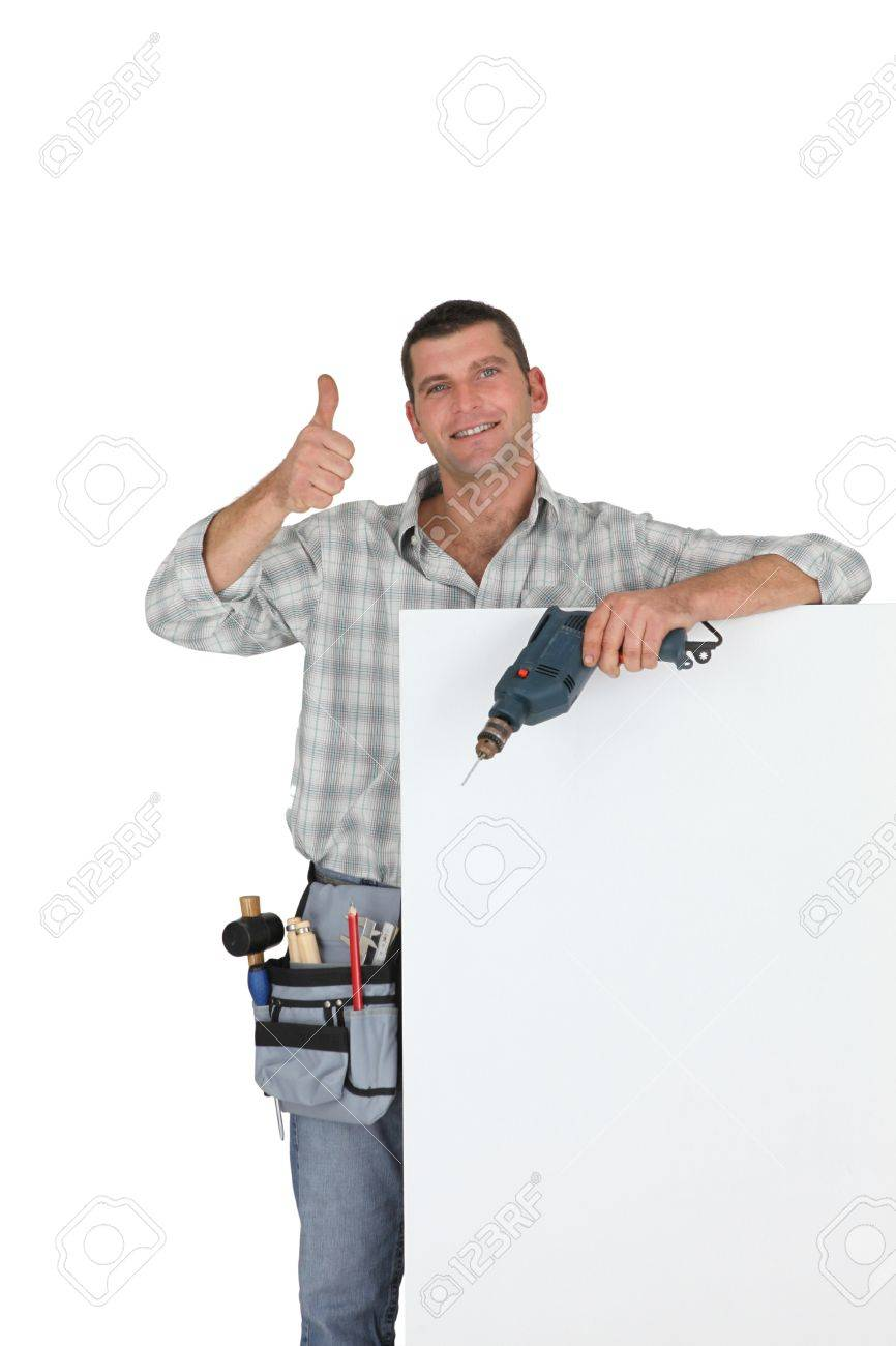 Thumbs up from a builder with a blank board Stock Photo - 11843841