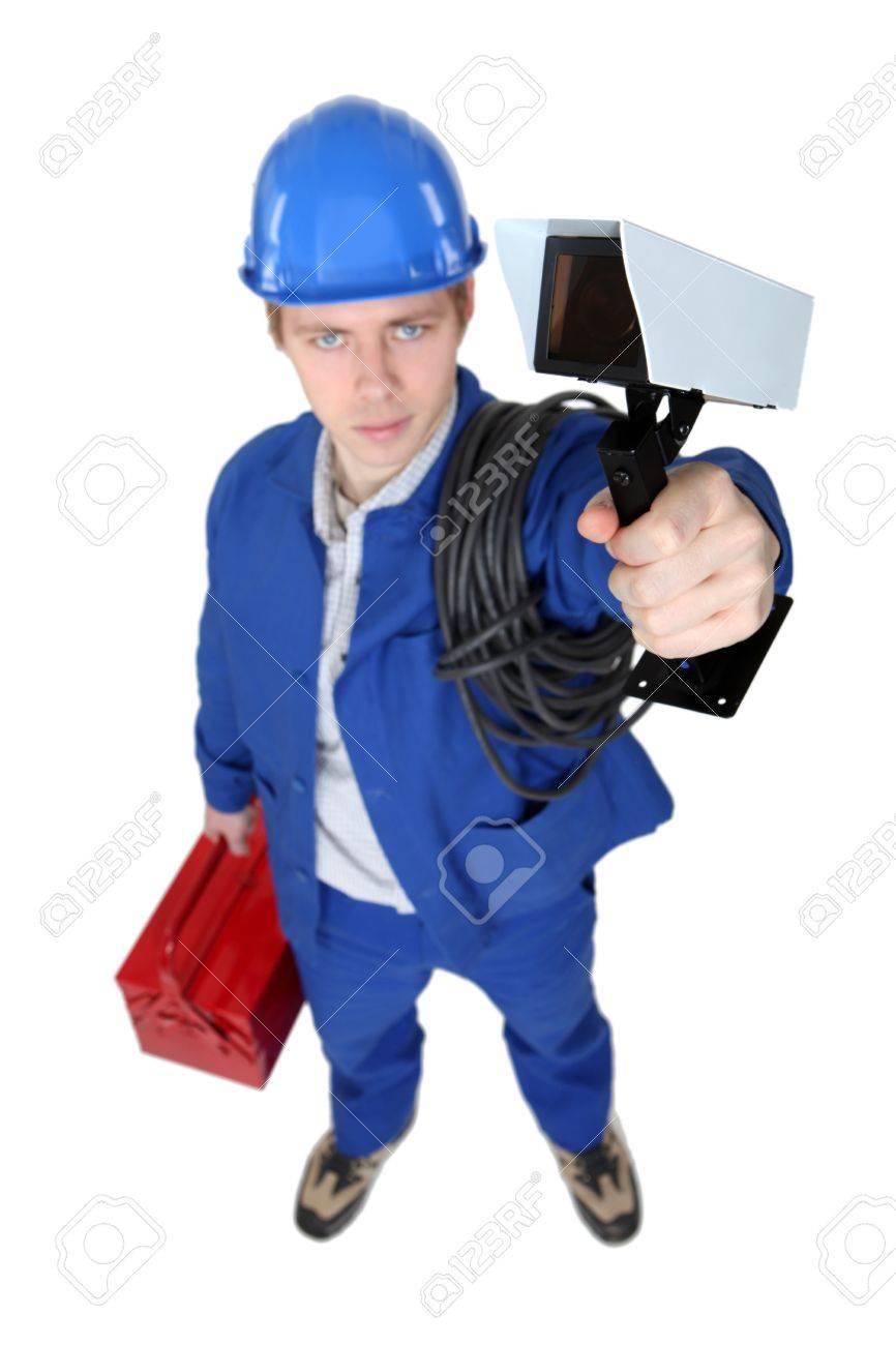 tradesman holding a surveillance camera stock photo picture and stock photo tradesman holding a surveillance camera