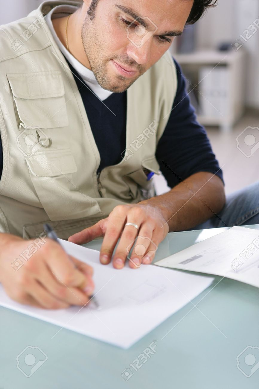 Man writing on a piece of paper Stock Photo - 11913466