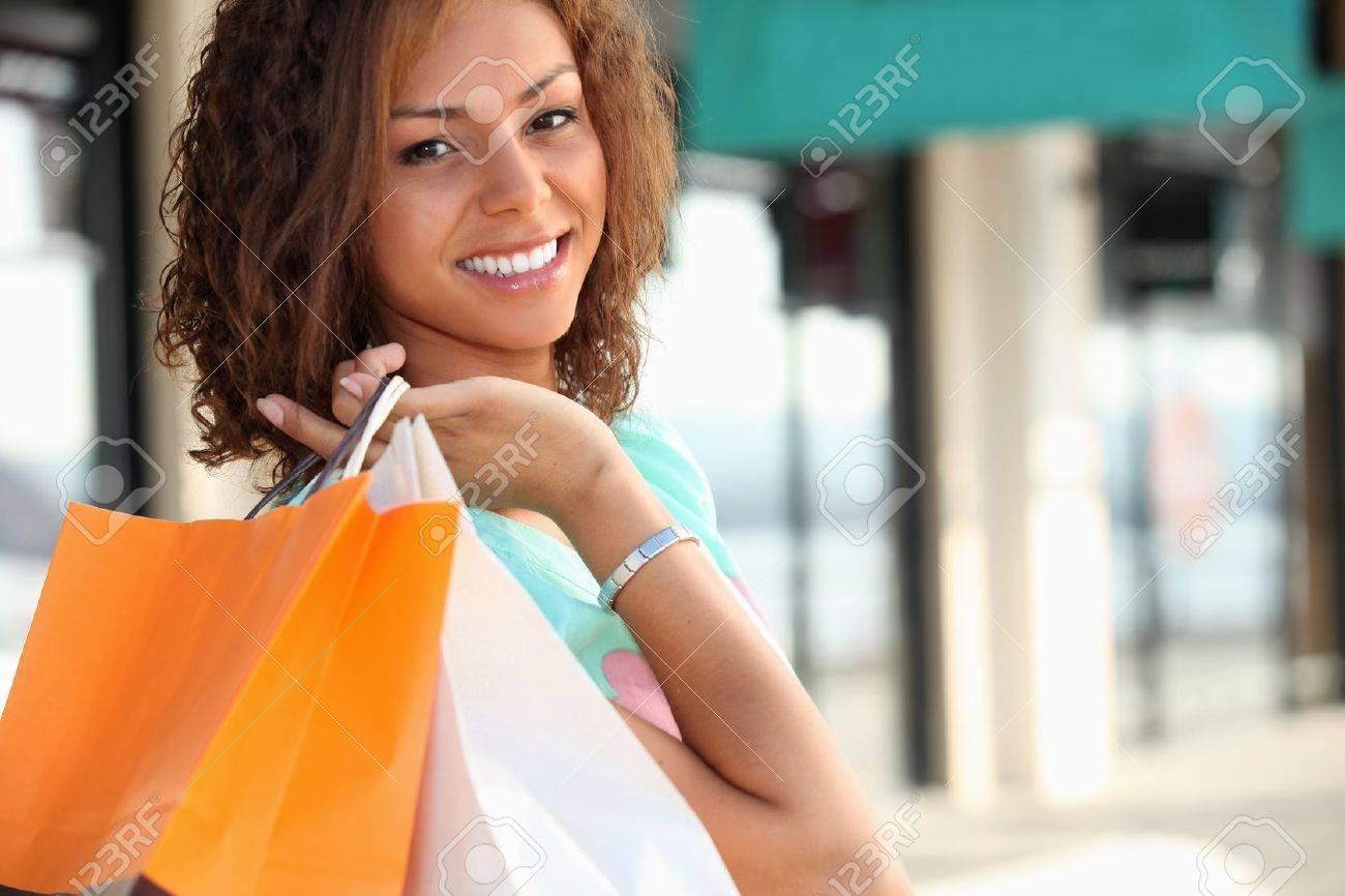 Smiling Metis woman carrying shopping bags Stock Photo - 11912882