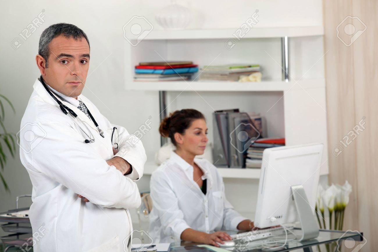 Doctor with his secretary Stock Photo - 11913074