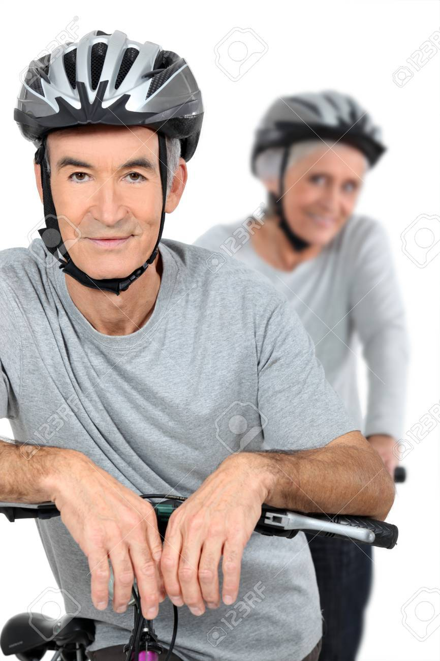 Elderly couple cycling Stock Photo - 11913517