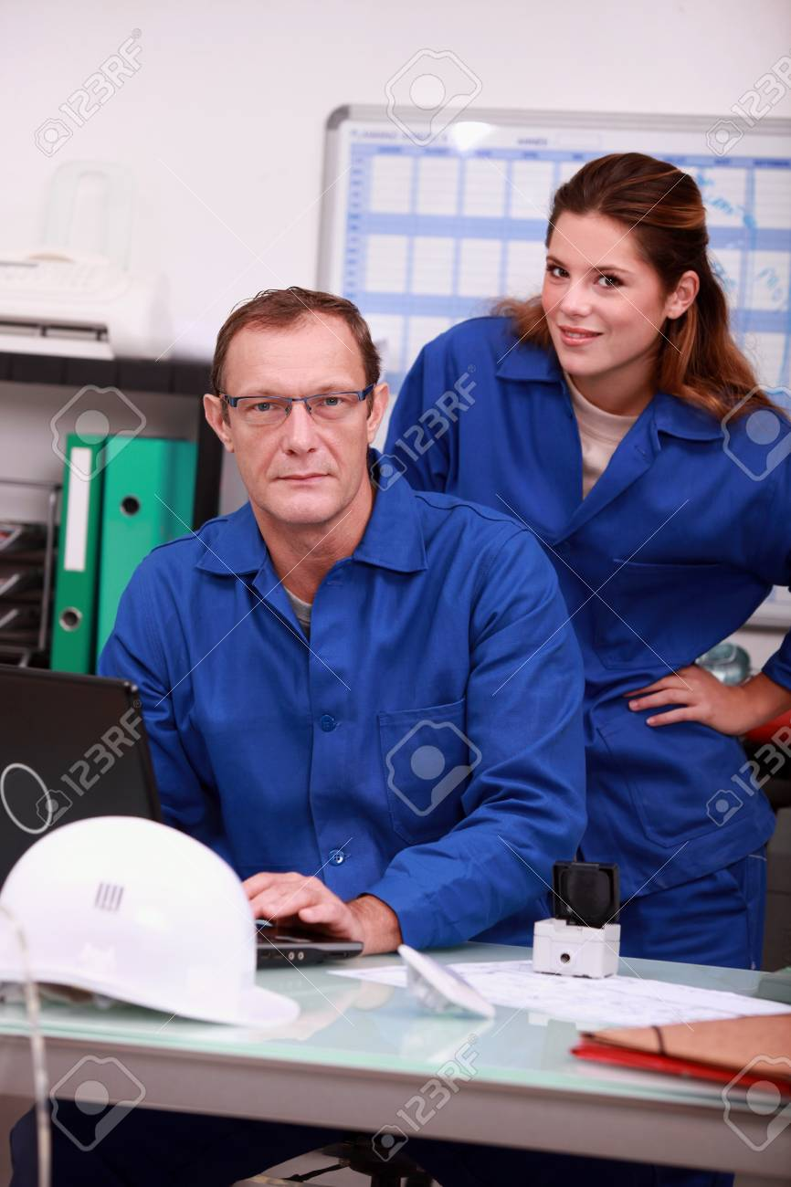 Workers looking up parts on the internet Stock Photo - 11935041