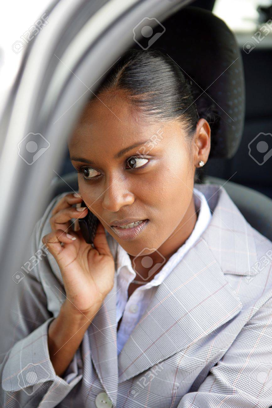 Businesswoman making a call from her car Stock Photo - 11934998