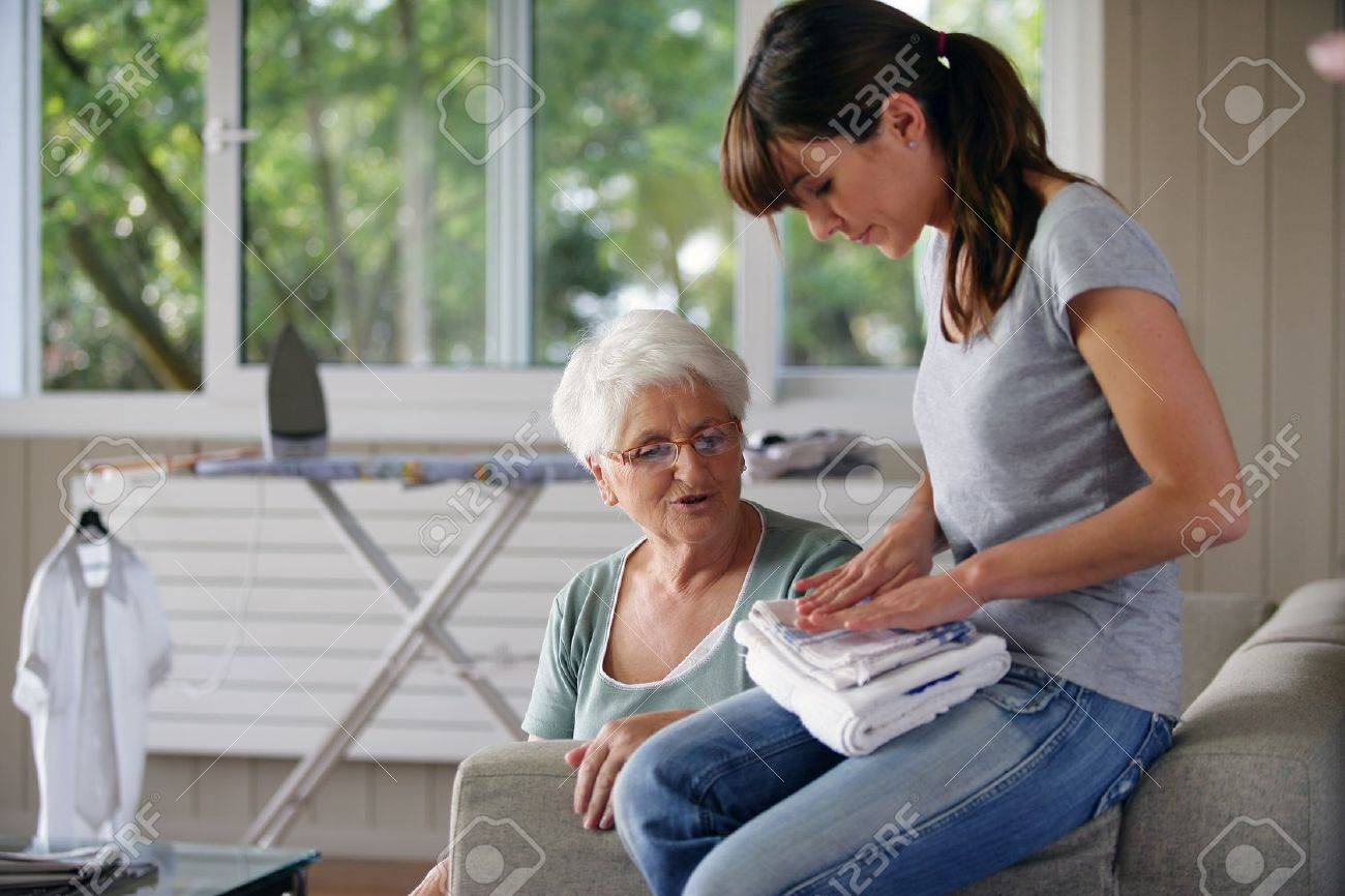 young woman helping senior lady with the housework Stock Photo - 11934970