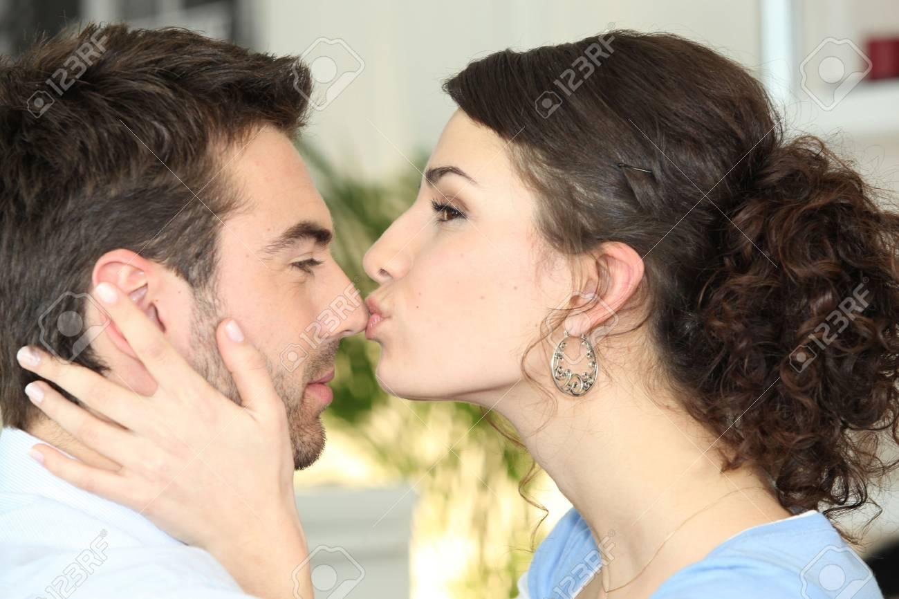 woman kissing her boyfriend Stock Photo - 11947196