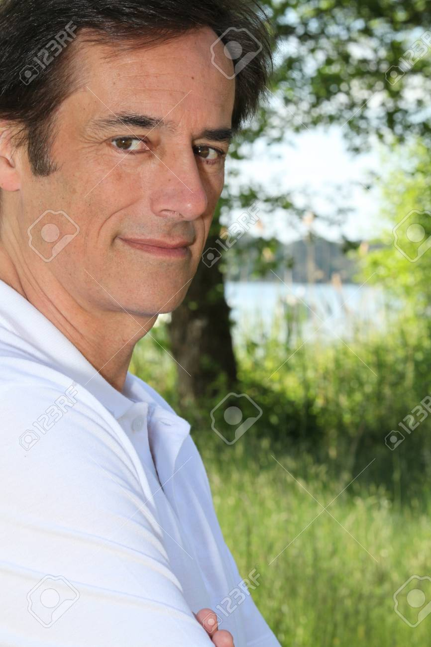 Man smiling in front of tree Stock Photo - 11946995