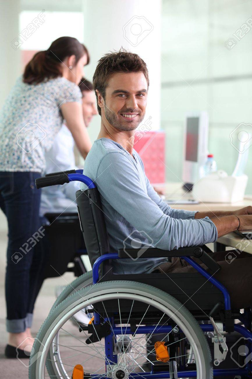 Man in wheelchair at work Stock Photo - 11971926