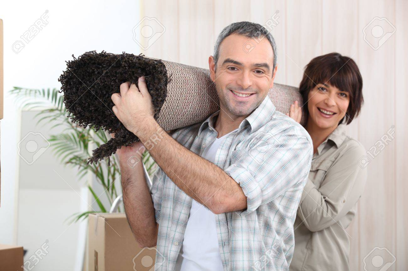 Couple carrying rug Stock Photo - 11972856