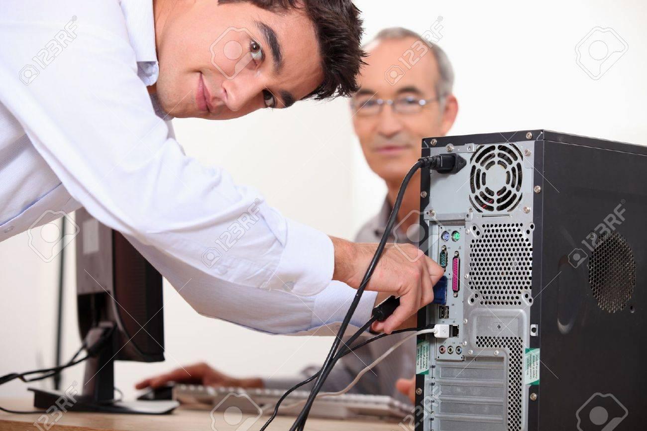 Computer technician repairing PC Stock Photo - 11972036