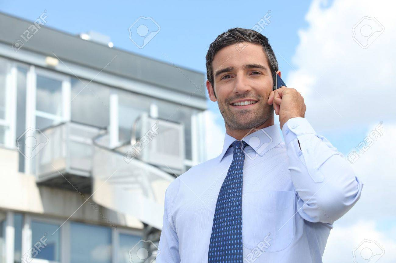 Businessman on mobile telephone - 12068795