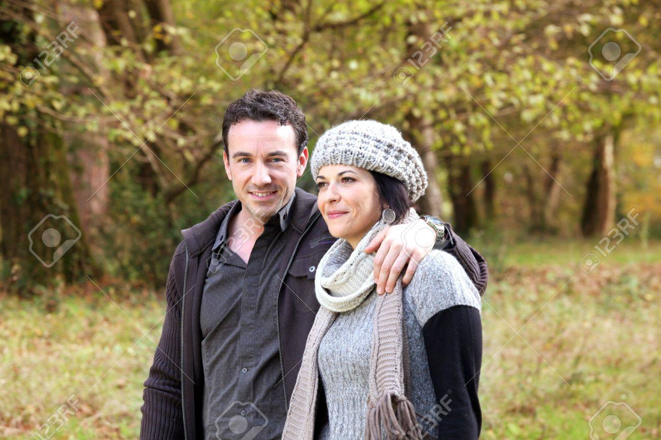Couple walking through park in autumn Stock Photo - 12006142
