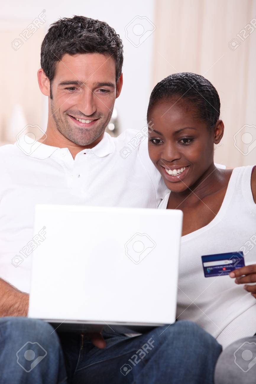 Couple with a laptop and a credit card Stock Photo - 12006278
