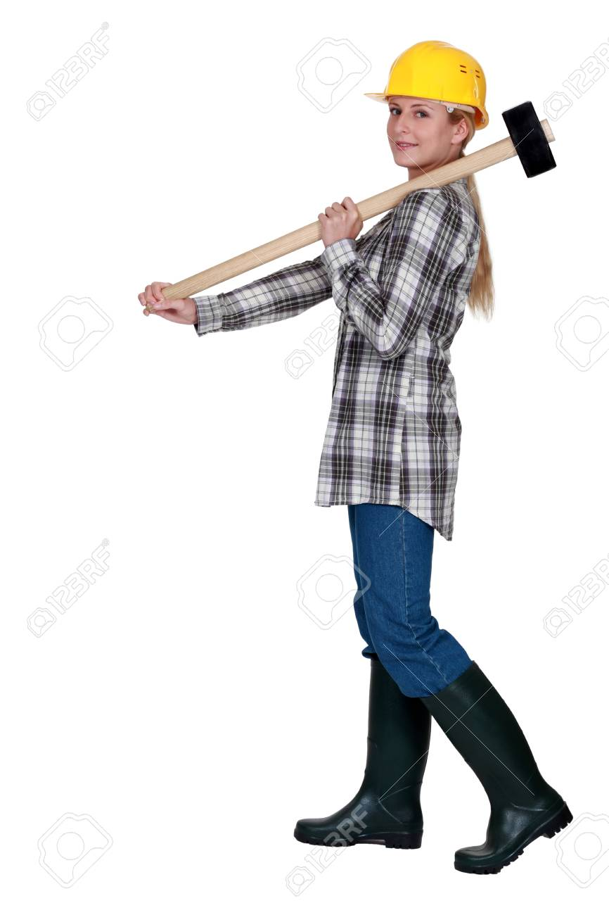 craftswoman holding a huge hammer Stock Photo - 12005422