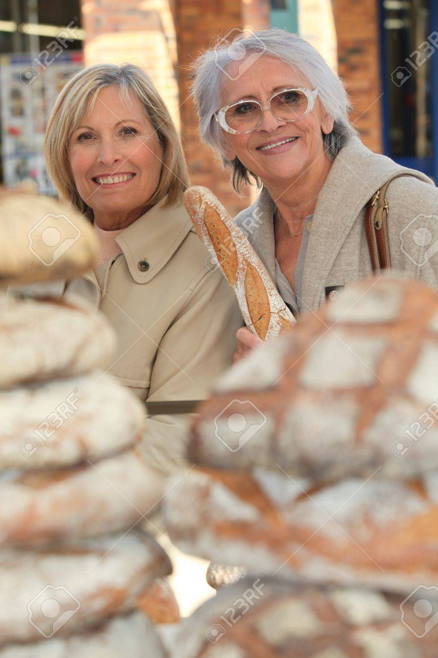 a 50 years old woman and a 70 years old woman in a bakery Stock Photo - 12006375