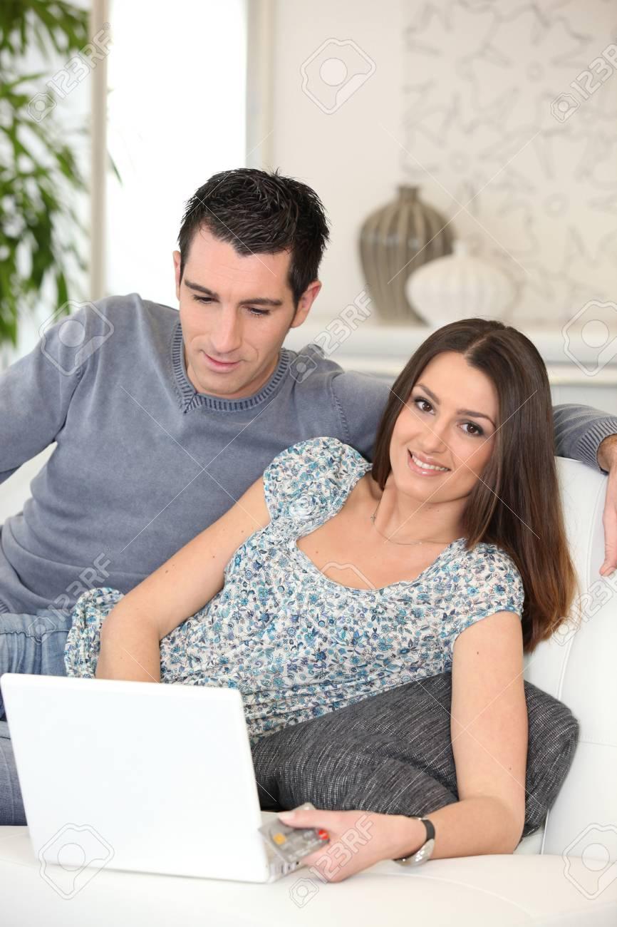 Couple shopping online Stock Photo - 12057917