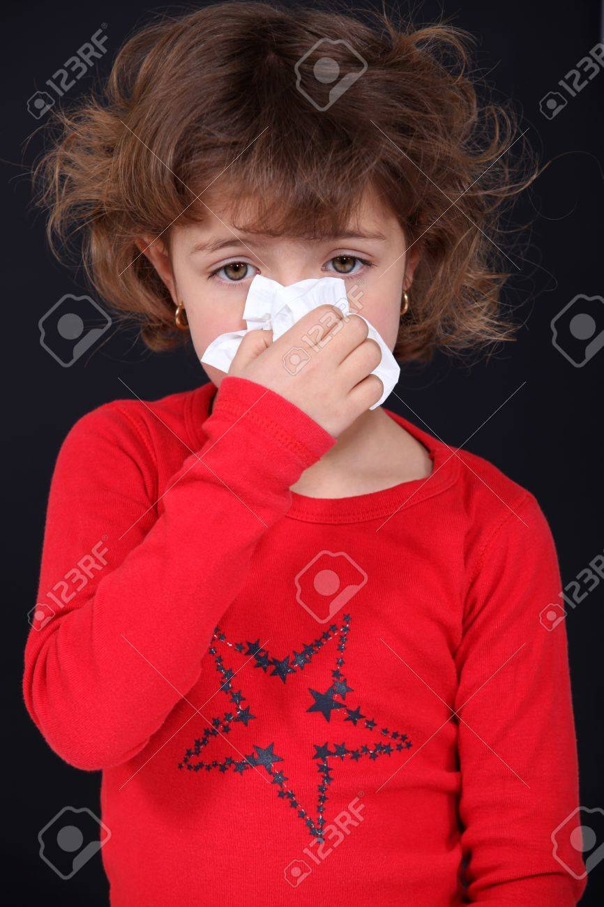 Young girl blowing her nose Stock Photo - 12057800