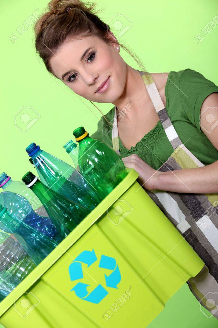 Young woman taking out the recycling Stock Photo - 12057839