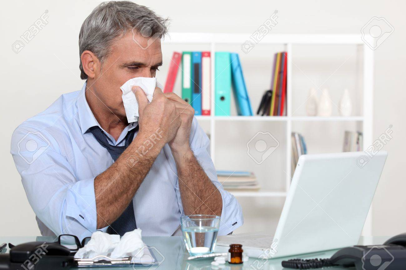 Office worker suffering from a cold Stock Photo - 12057689
