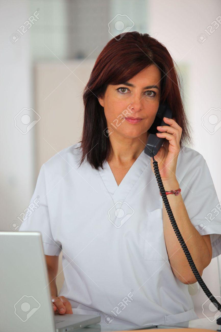 Medical secretary answering the telephone Stock Photo - 12057707