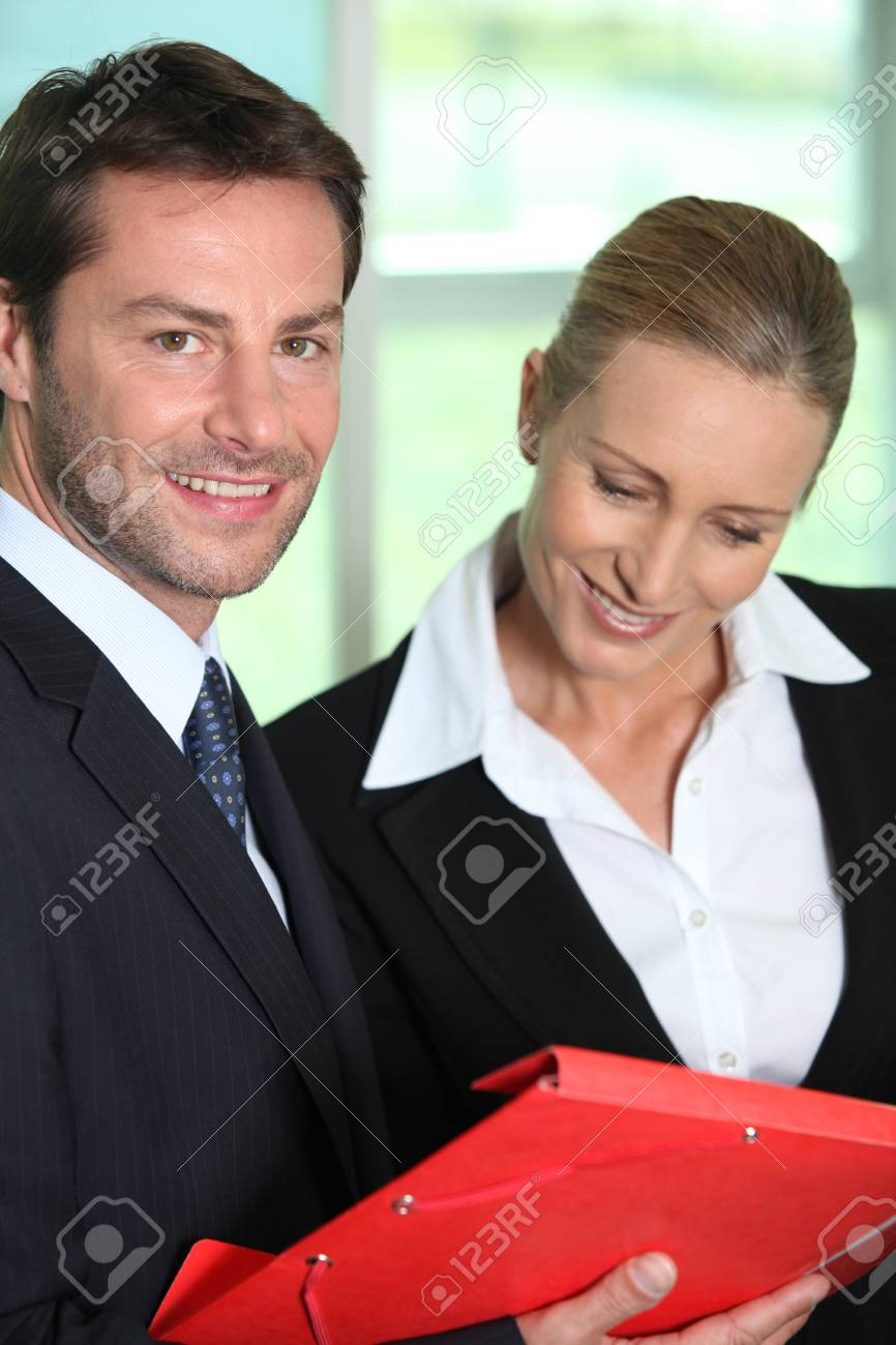 Businesswoman looking at businessman Stock Photo - 12089767