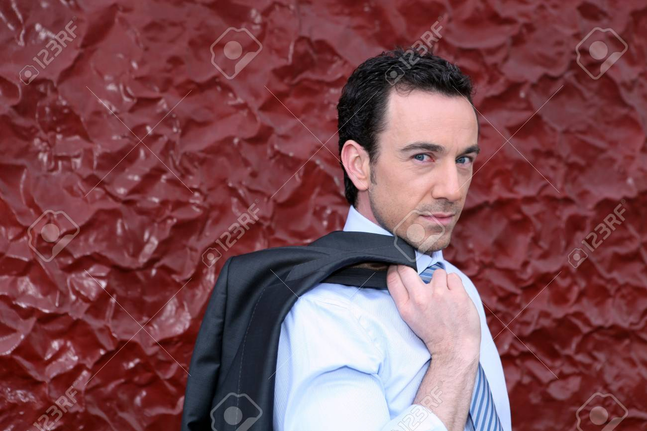 Businessman holding his jacket over his shoulder Stock Photo - 12090172